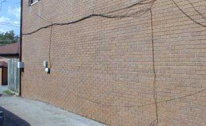 Brick wall after graffiti removed