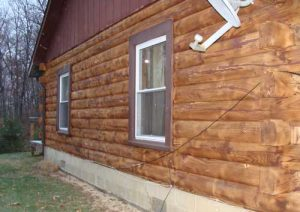 Log cabin side after paint removed