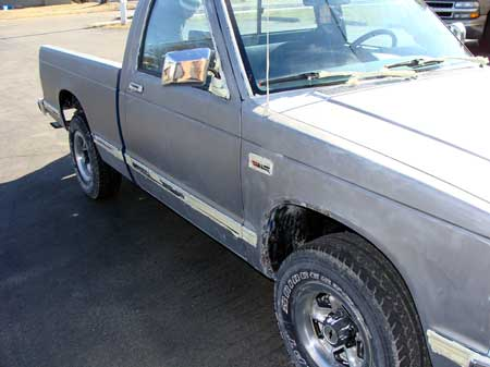 Pickup truck after paint removed by soda cleaning