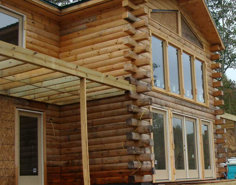 Log home showing difference between before and after cleaning.